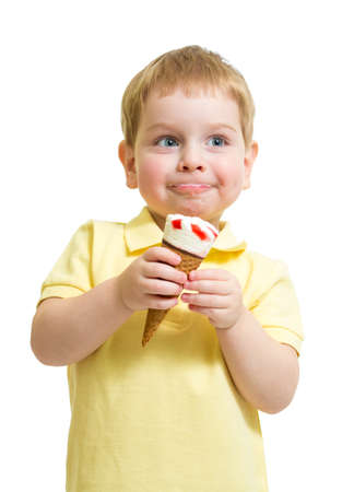 Kid boy eating ice cream with pleasure  isolated on white photo