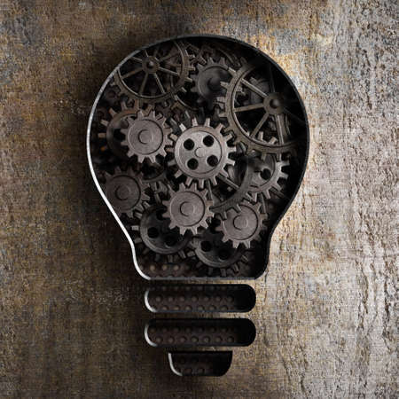team work: lighting bulb business concept with working gears and cogs in rusty metal background Stock Photo