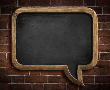 speech bubble blackboard on brick wall background photo