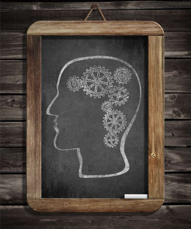 Human brain mechanism with cogs and gears drawn by chalk on blackboard photo