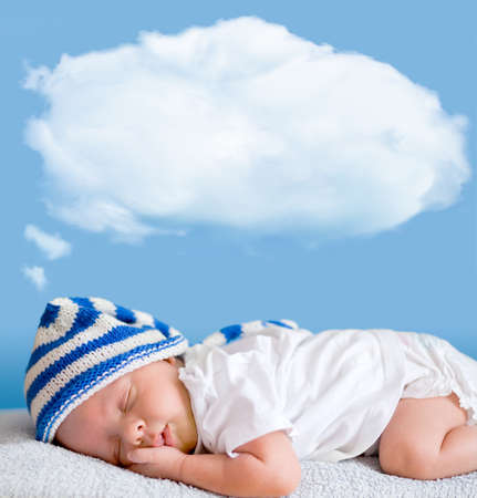 sleeping baby closeup portrait with dream cloud for image or text photo