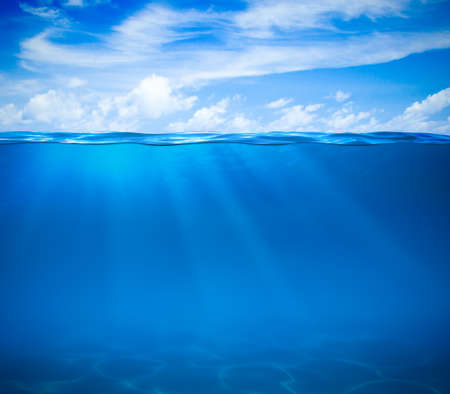 Sea or ocean water surface and underwater photo