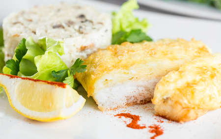chees: Fish fillet baked with chees  and risotto with mushrooms