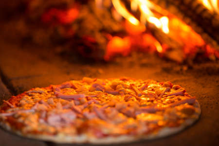 Pizza baking in oven Stock Photo