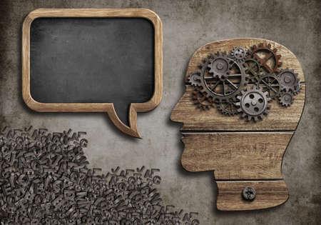 psychical: wooden head with speech bubble blackboard