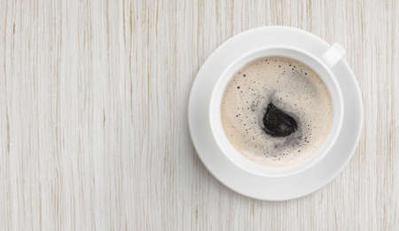 wooden table top view: black coffee on white wooden table top view Stock Photo