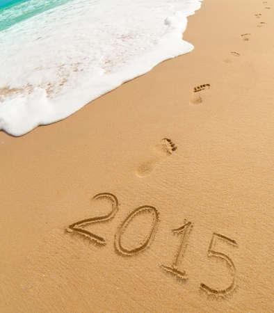 2015 and footprints on sand beach photo