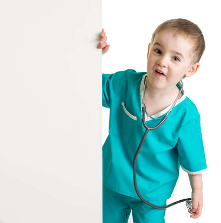 little boy in doctor suit behind blank banner isolated photo