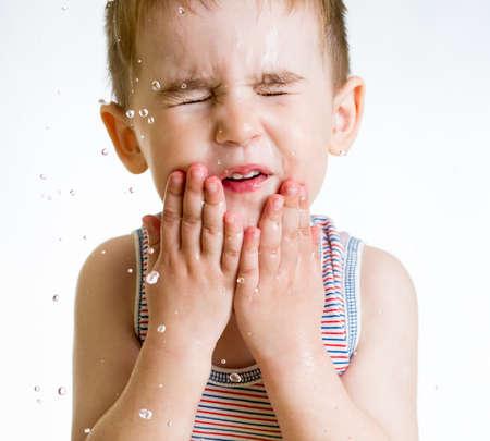 squint: squint little child washing