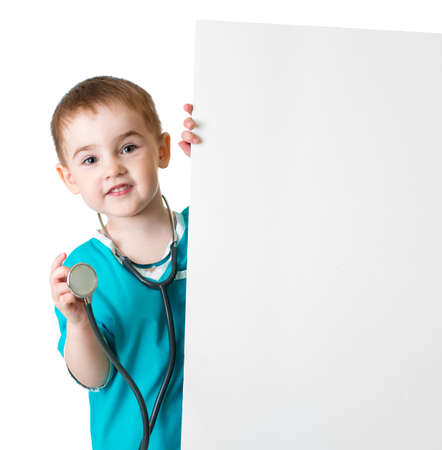little doctor kid behind blank banner isolated photo