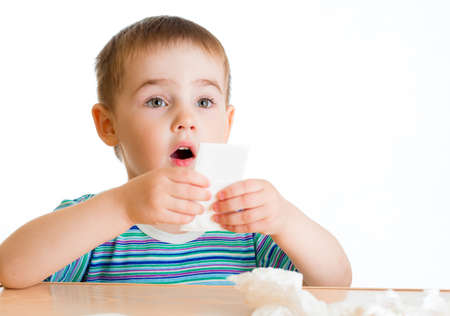 Child going to wipe with tissue photo
