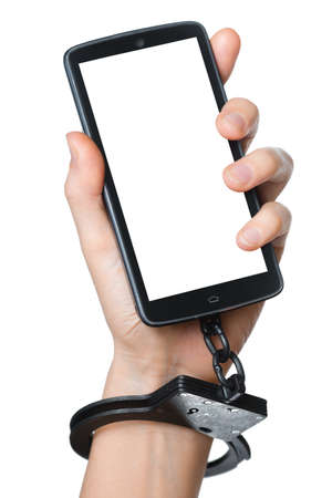 unfreedom: Mobile phone addiction concept  Smartphone with blank screen for your picture and handcuff in hand isolated on white  Stock Photo