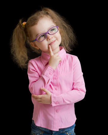hyperopia: Adorable child girl in eyeglasses isolated on black Stock Photo