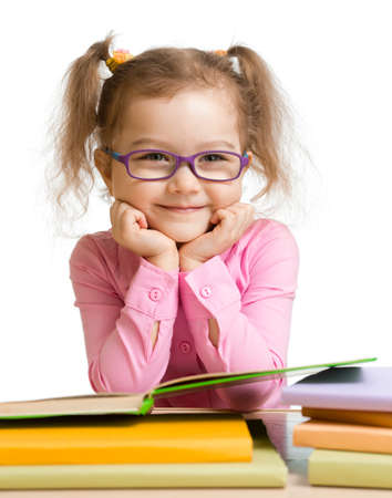 hyperopia: child girl in glasses reading book and smiling