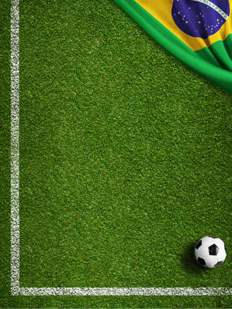 Soccer field with ball and flag of Brazil photo