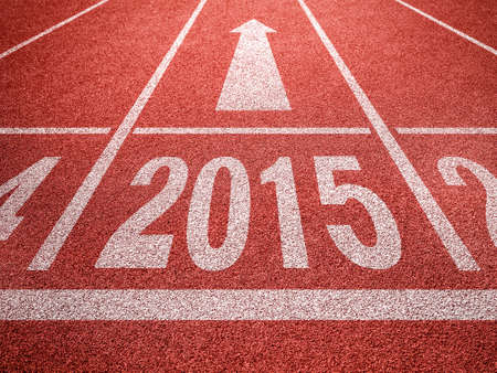 New year 2015 diggits on sport track with arrow  Good start, growing business concept