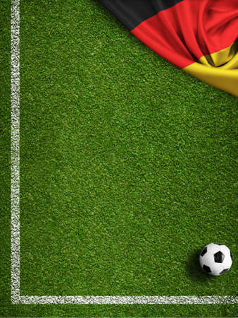 Soccer field with ball and flag of Germany photo
