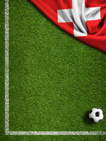 football pitch: Soccer field with ball and flag of Switzerland
