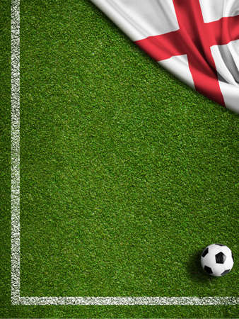 Soccer field with ball and flag of England photo