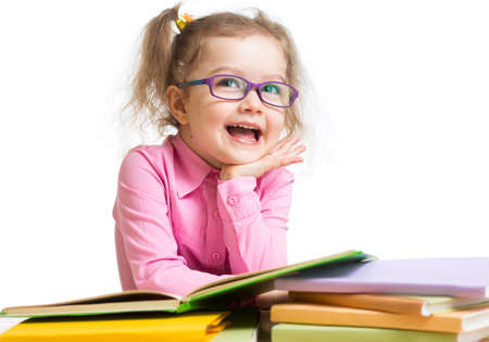 hyperopia: Funny kid girl in glasses reading books