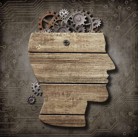Open brain model made from wood, rusty metal gears and cogs photo