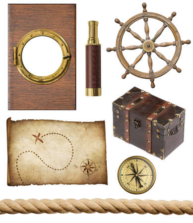 nautical objects set isolated  ship window or porthole, old treasure map, spyglass, brass compass, pirates chest, rope and steering wheel photo