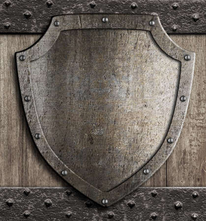 wooden plaque: medieval shield on wooden gate
