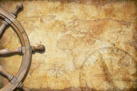 vintage world map: aged treasure map with steering wheel Stock Photo