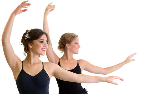 Two beautiful young girls making exercise or dancing together  isolated photo