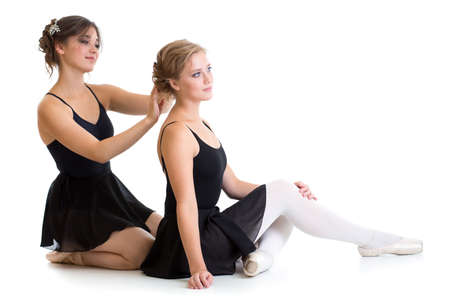 Two beautiful young dancers preparing for training together isolated photo