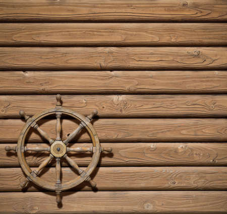 wheel house: Stering wheel over wood background