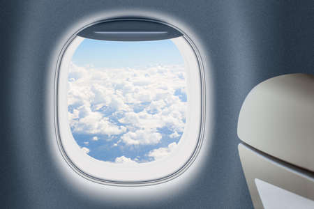 Aeroplane or jet window with clouds behind, traveling concept. photo