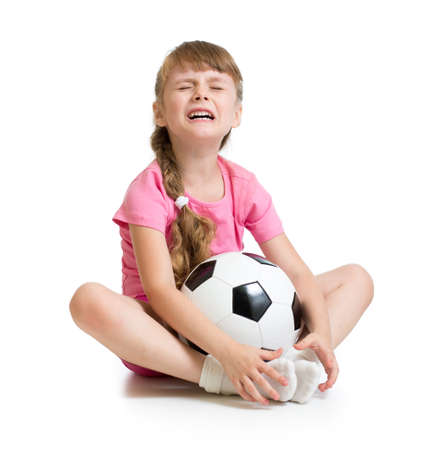 Crying girl with soccer ball isolated on white photo