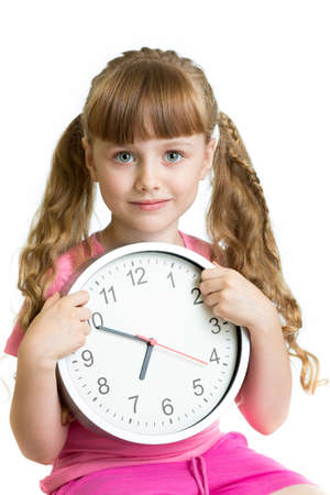 seven o'clock: Girl displaying seven oclock time in studio isolated Stock Photo