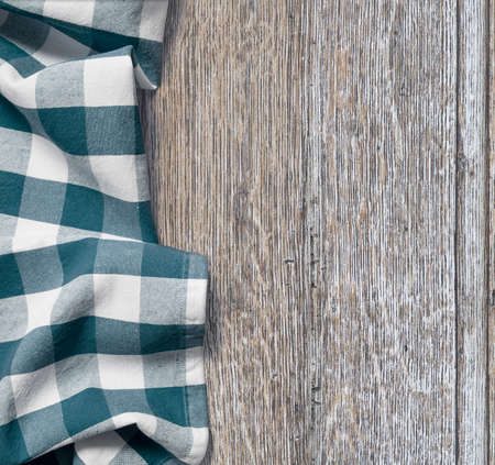 picnic cloth over old wooden table grunge background photo