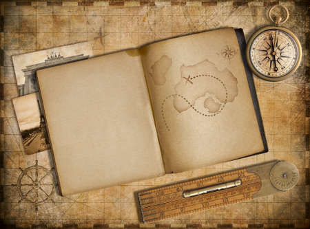 Adventure and travel concept. Vintage map, copybook and compass photo