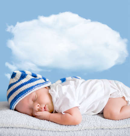 sleeping baby closeup portrait with cloud photo