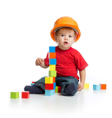 little kid in hard hat with building blocks photo