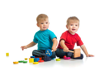 Happy kids playing wooden toys together Stock Photo