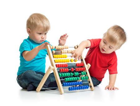 Kids playing colorful abacus or counter together Stock Photo
