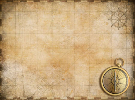 parchments: old map with brass compass as exploration and adventure background