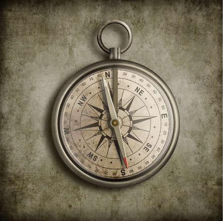 old compass over vintage background photo