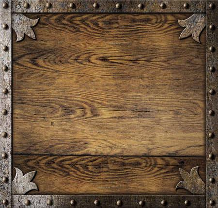 medieval metal frame over old wooden background 스톡 콘텐츠