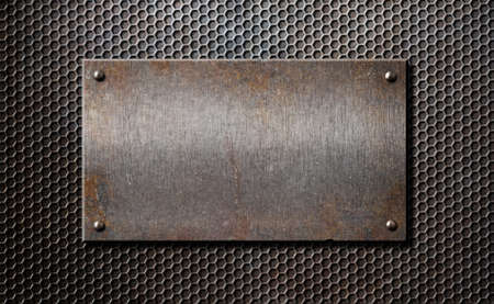old rusty metal plate over comb grid or grille background photo