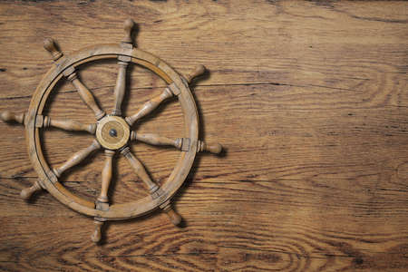 wheel house: Steering wheel over wood background wall