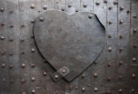 symbols metaphors: old metal heart as a metaphor