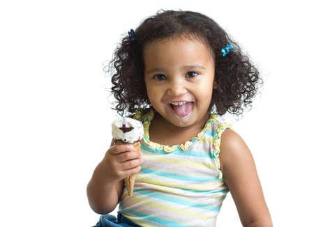 Kid eating ice cream isolated on white photo