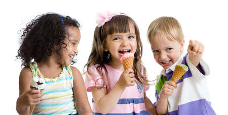 happy kids eating ice cream in studio isolated on white
