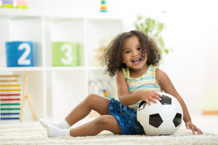 Kid girl playing toys at home or kindergarten photo