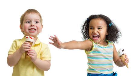 child ice cream: Happy kids eating ice cream isolated on white